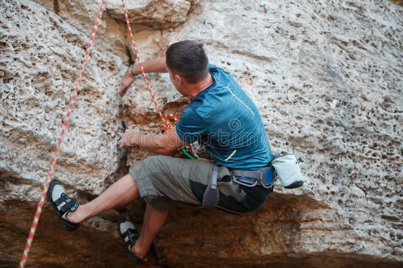 Image from back of rock climber stock image