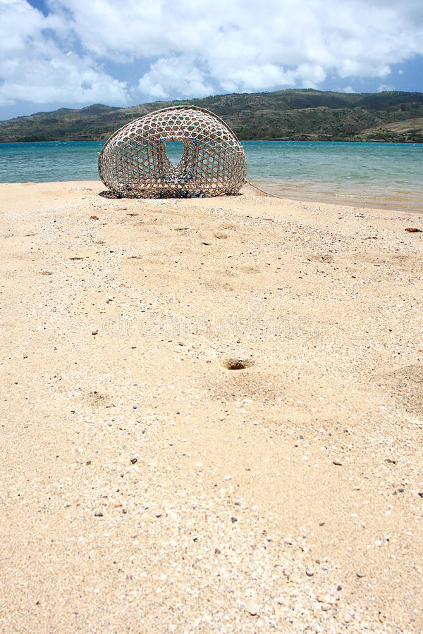Bamboo fish trap on the beach, Rodrigues Island. Image of a bamboo fish trap on a stretch of white coralian sand stock images