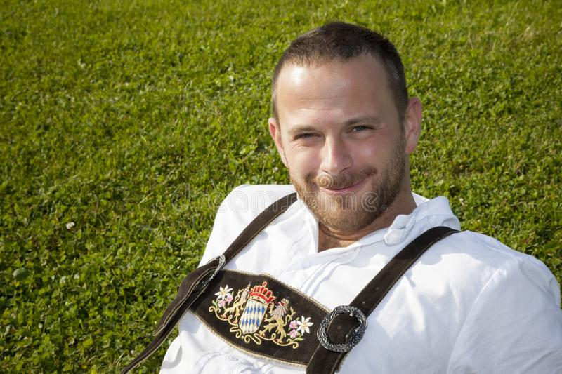 Bavarian tradition man in the grass stock photo