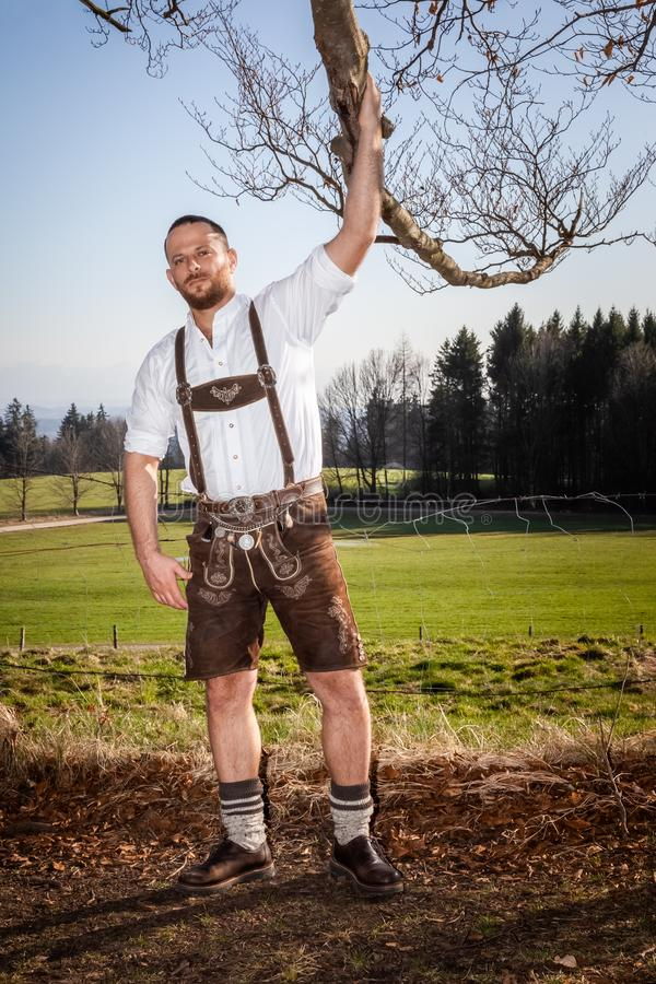 Bavarian tradition man in the grass royalty free stock images
