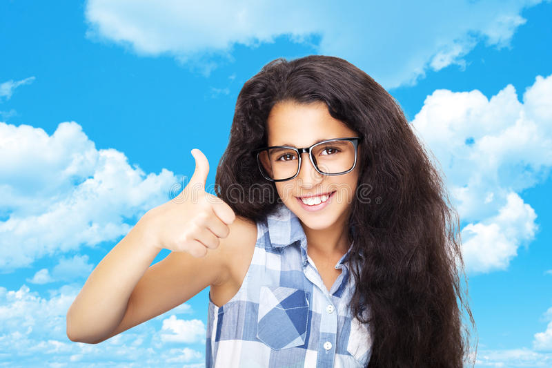 Image of a beautiful African young girl wearing glasses royalty free stock images