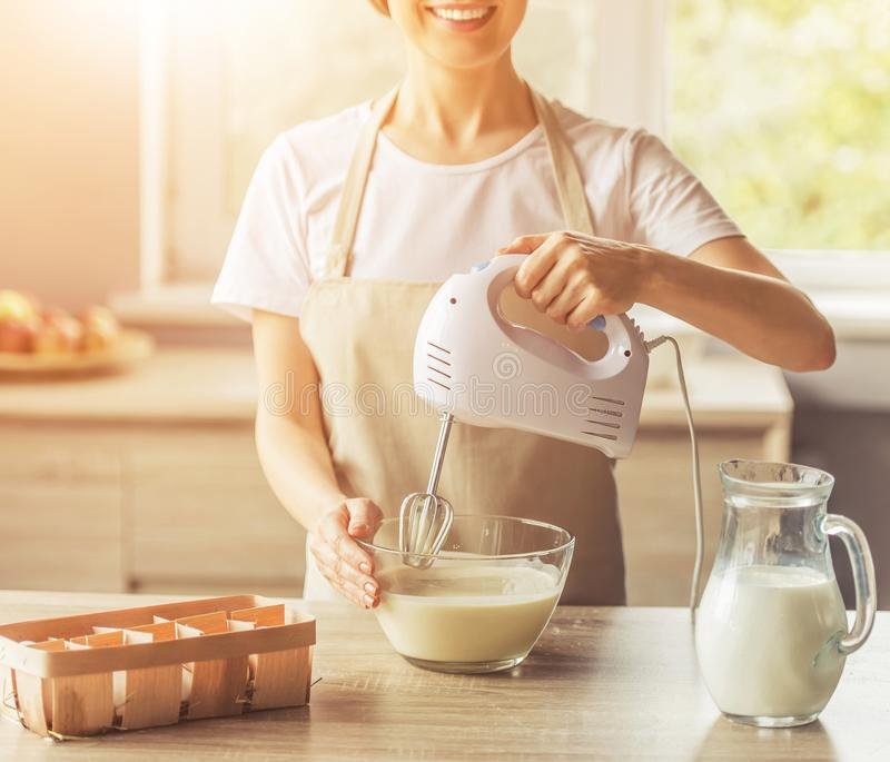 Image of Beautiful Cute Woman in Apron Smiling. stock photo