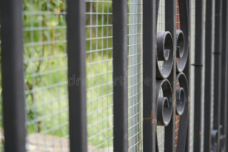 Image of a Beautiful decorative cast iron wrought fence with artistic forging. Metal guardrail close up. Old, architecture, safety, antique, wall, ornate royalty free stock image
