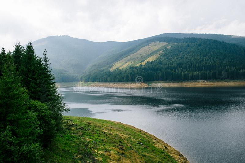 Beautiful mountain landscape with river view from Transalpine, the Carpathian Mountains. Horizontal outside shot. royalty free stock photos