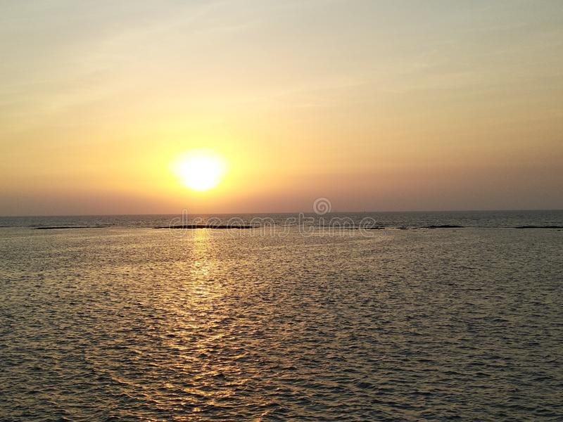 Sunset from the sea side of Mumbai`s slum Geeta nagar. It is a image of beautiful sunset from the sea side in Mumbai`s slum area Geeta Nagar . You can see royalty free stock photography