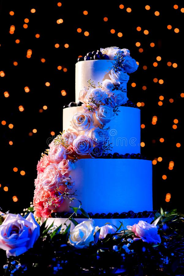 Image of a beautiful wedding cake with roses stock photo