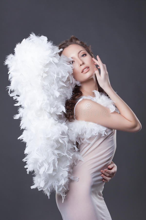 Image of beautiful woman posing with angel wings