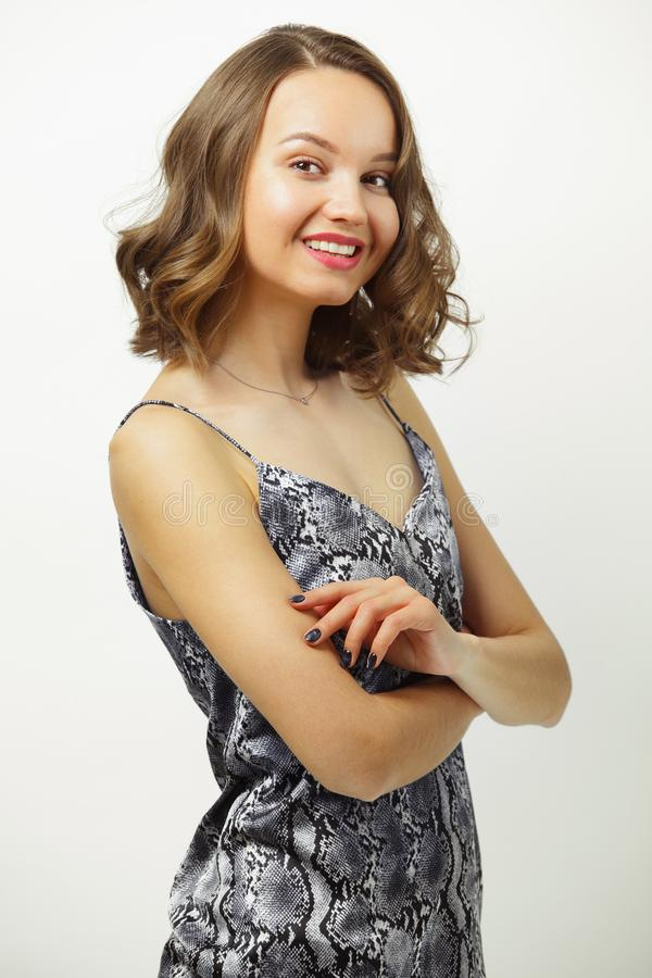 Image of beautiful woman in summer open t-shirt, smiling sincerely, with short hair cut to shoulders, has cute stock photo