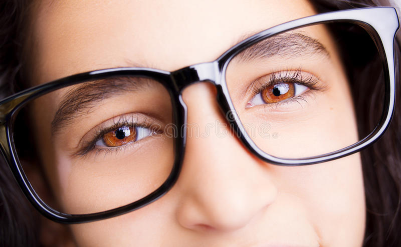 Image of a beautiful young girl wearing glasses. royalty free stock image