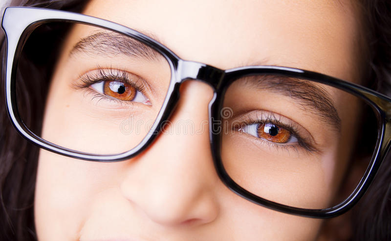 Image of a beautiful young girl wearing glasses. royalty free stock images