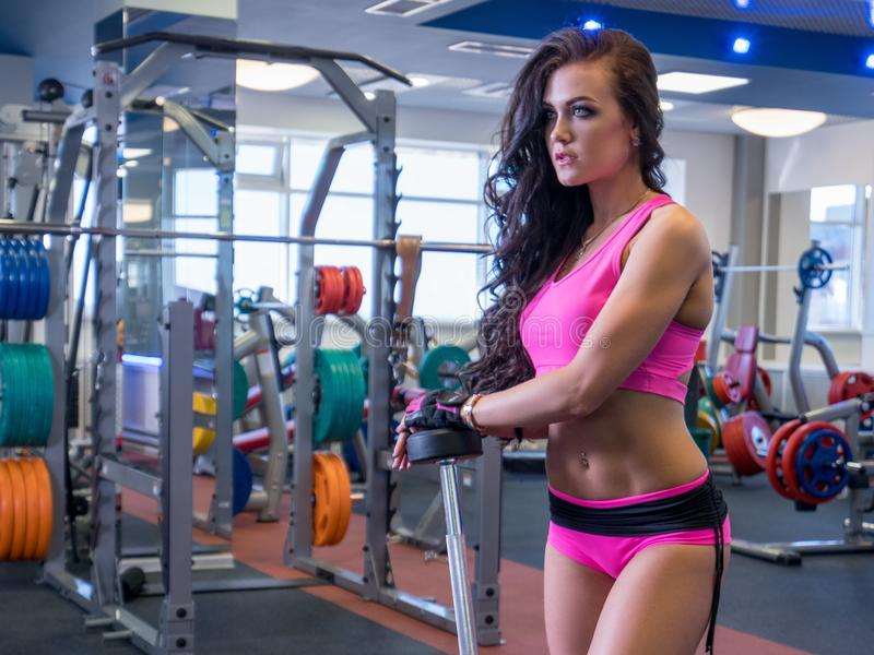 Beautiful young woman engaged in sports hall royalty free stock image