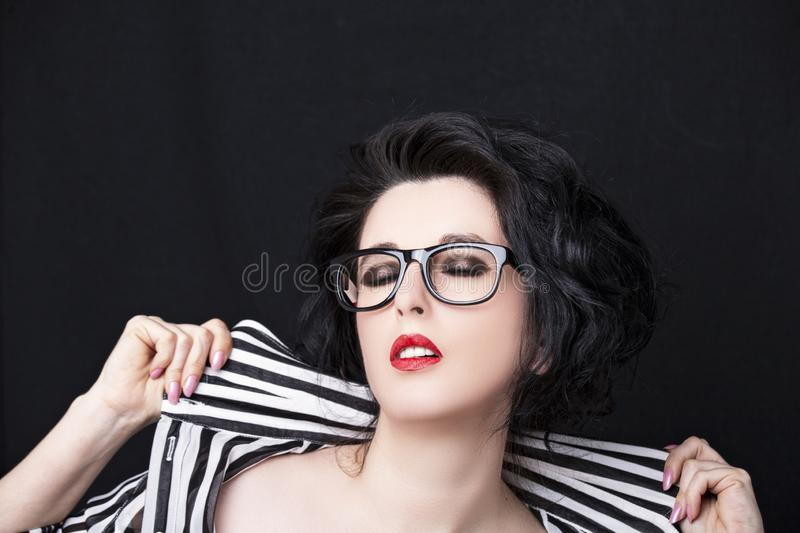 Image of a beautiful young woman wearing glasses royalty free stock images