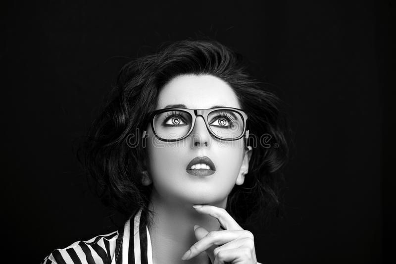Image of a beautiful young woman wearing glasses stock photography