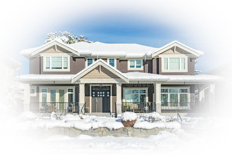Image of big family house in snow on winter season with white borders. Image of big residential house in snow on winter season in Canada with white round border royalty free stock photography