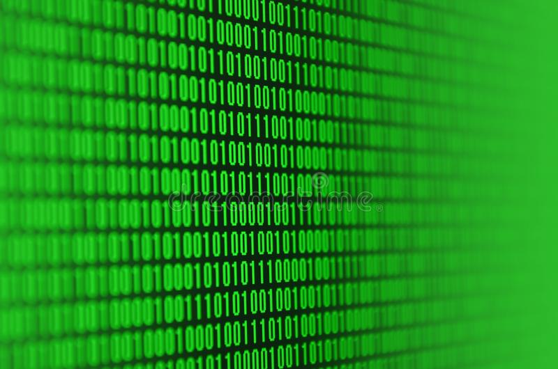 An image of a binary code made up of a set of green digits on a black background.  royalty free stock photography