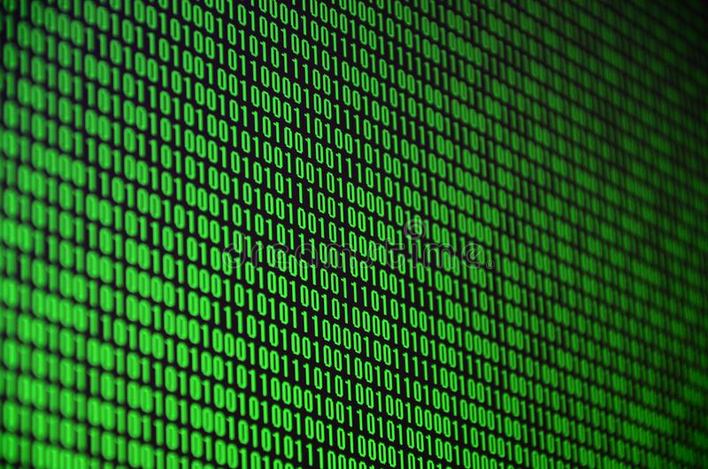 An image of a binary code made up of a set of green digits on a black background.  royalty free stock photos