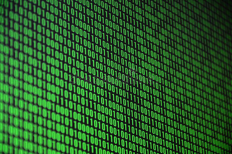 An image of a binary code made up of a set of green digits on a black background.  royalty free stock image