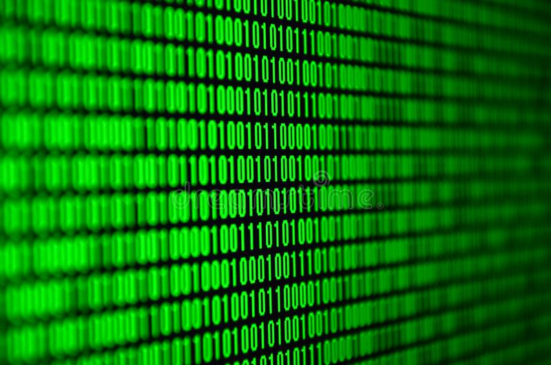 An image of a binary code made up of a set of green digits on a black background.  stock images