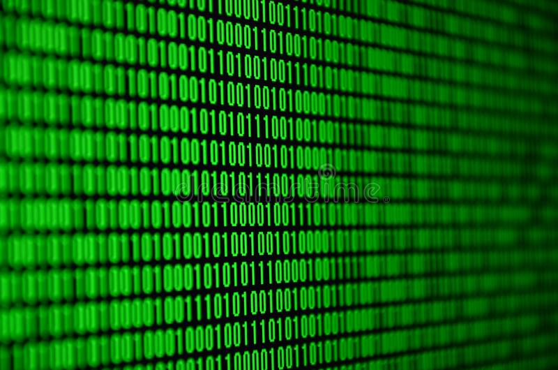 An image of a binary code made up of a set of green digits on a black background.  stock photo