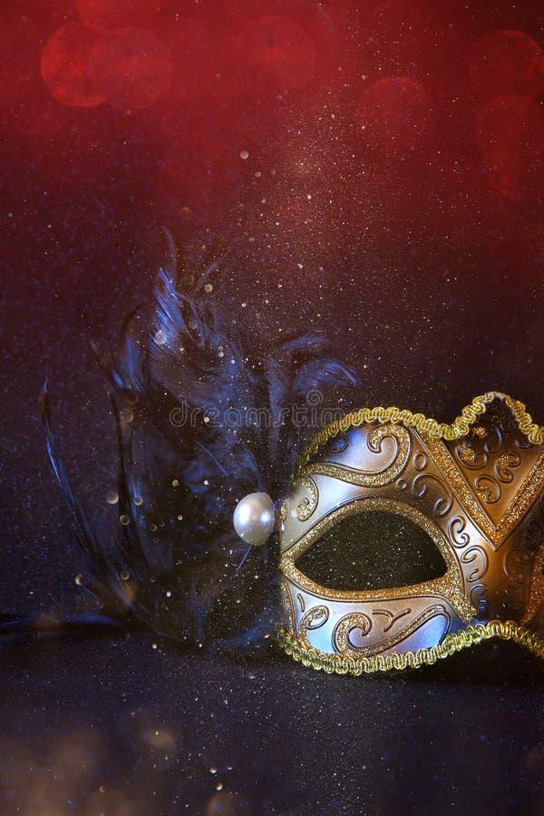 Image of black elegant venetian mask. On glitter background. Shiny overlay royalty free stock image