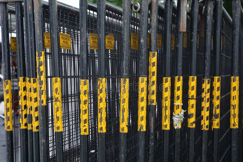 Yellow paint on edges of portable fencing. This is an image of black portable barricades with yellow caution paint on their edges in Portland, Oregon royalty free stock photo