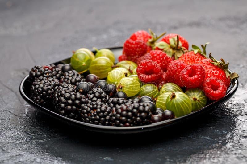 Image of blackberry, strawberry, raspberry, gooseberry, black currant stock photography