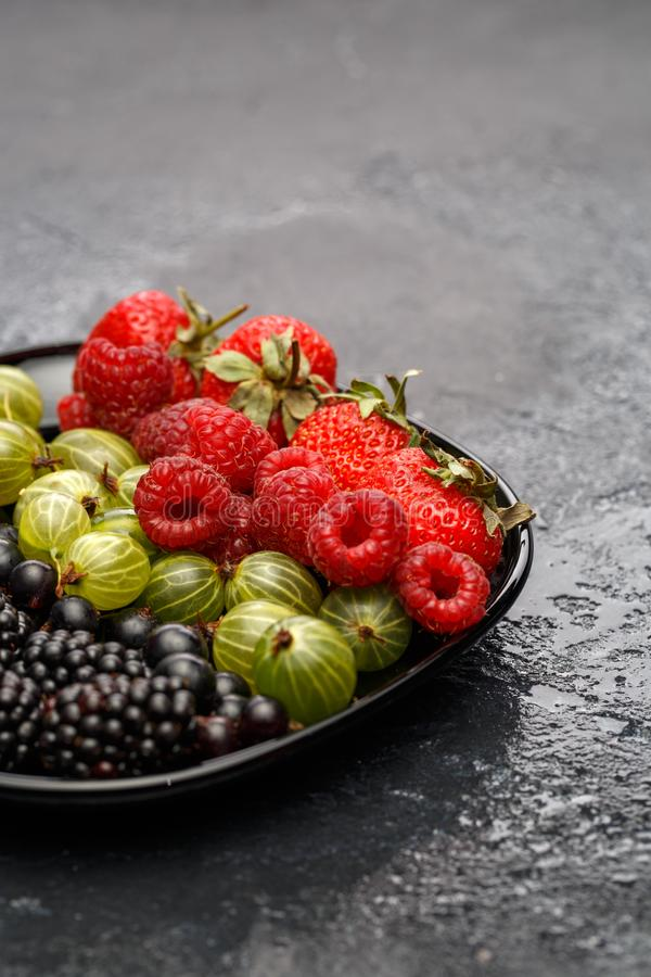 Image of blackberry, strawberry, raspberry, gooseberry, black currant royalty free stock photography