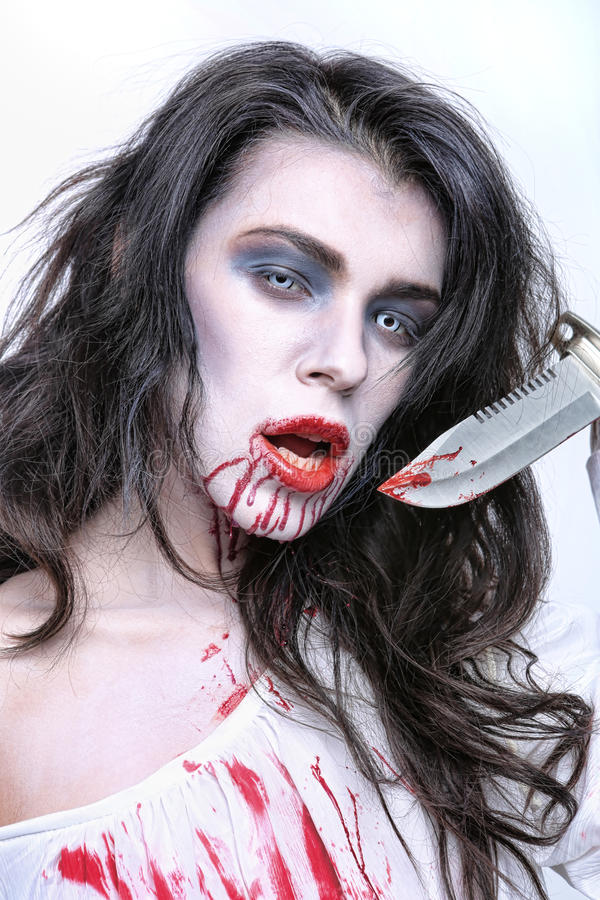 Image of a Bleeding Psychotic Woman royalty free stock photography
