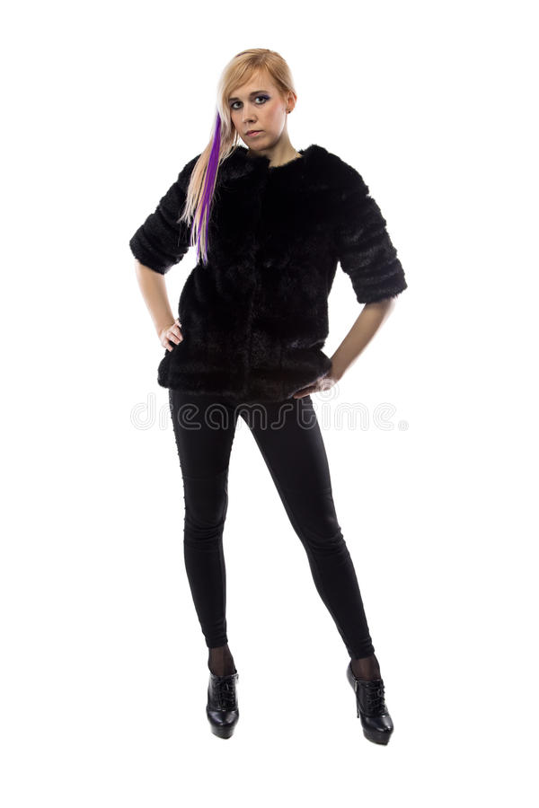 Image of blonde in black jacket, hands on hips royalty free stock photo