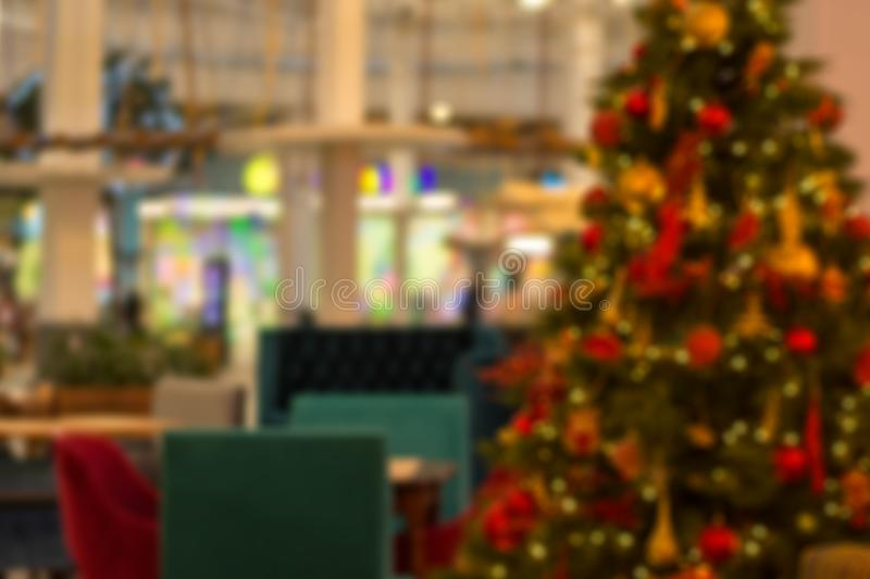 Image of blur restaurant and Christmas tree in night time for background usage.  stock image