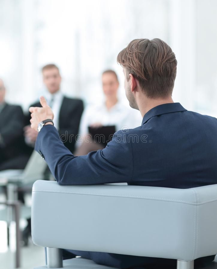 Image is blurred.businessman conducting a meeting royalty free stock image