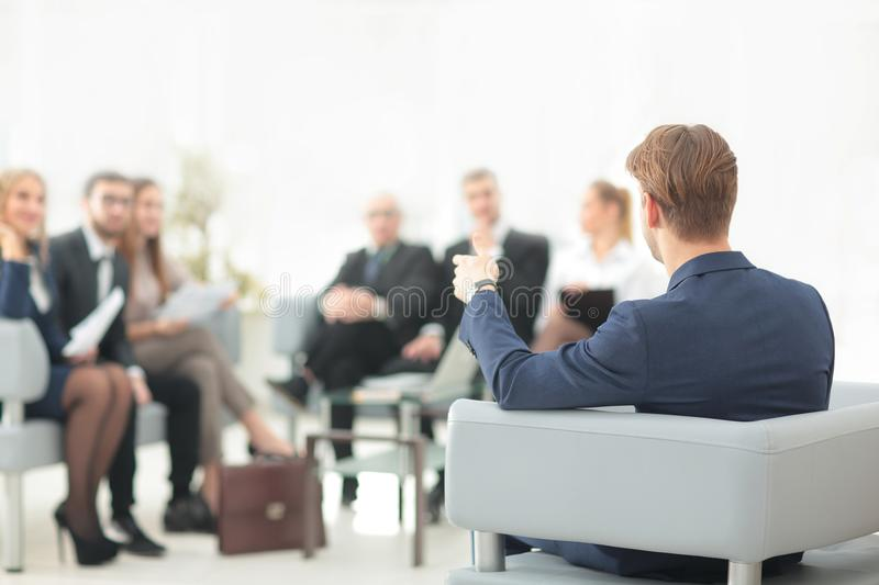 Image is blurred.businessman conducting a meeting stock image