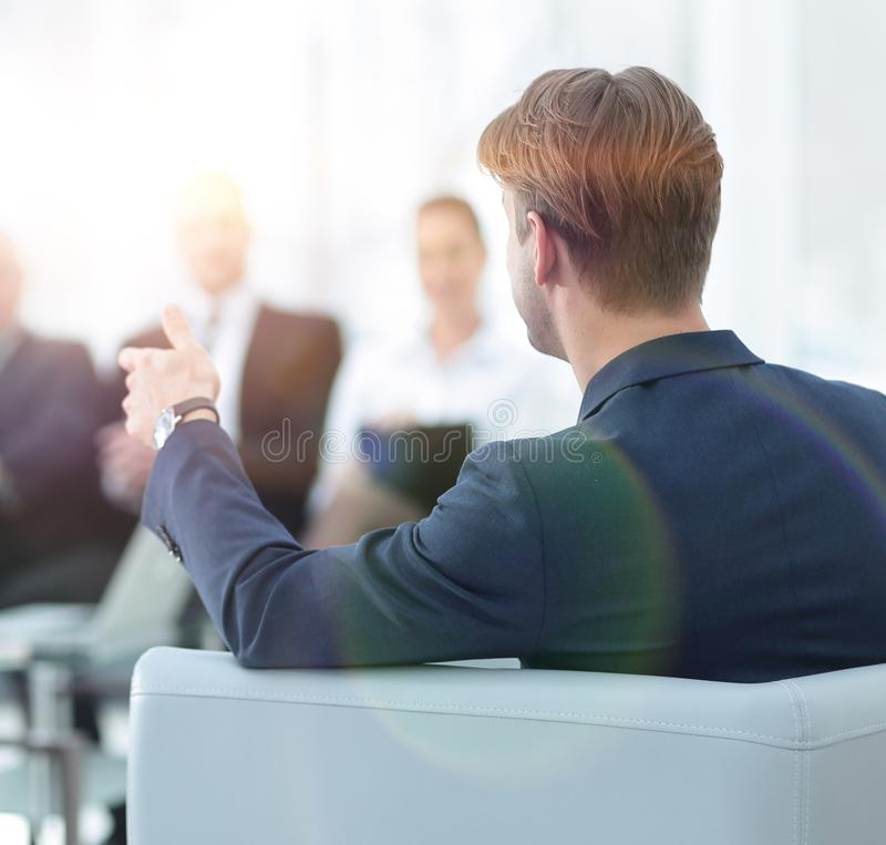 Image is blurred.businessman conducting a meeting stock photos