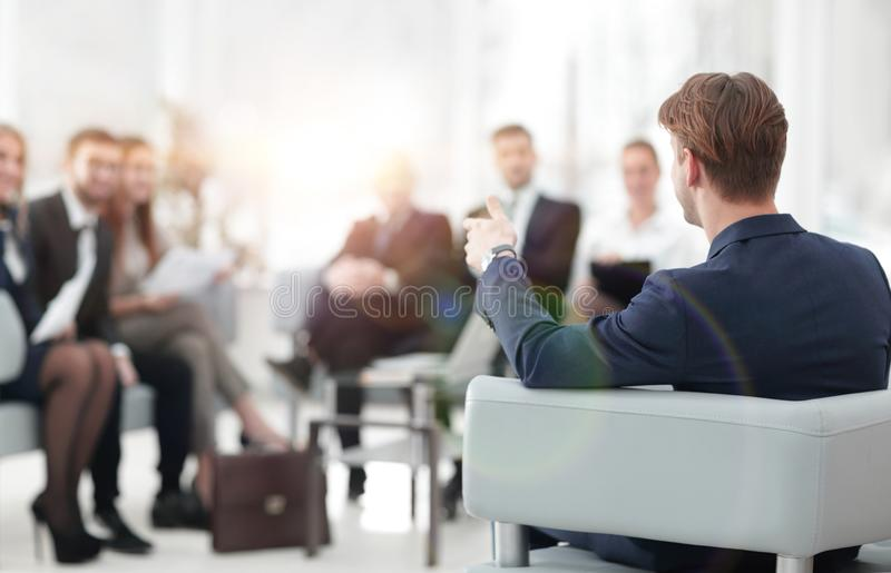 Image is blurred.businessman conducting a meeting royalty free stock photos