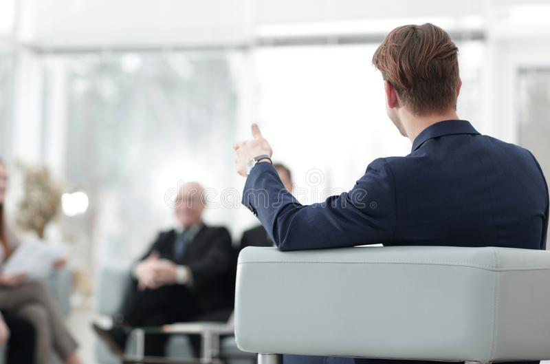 Image is blurred.businessman conducting a meeting royalty free stock photo