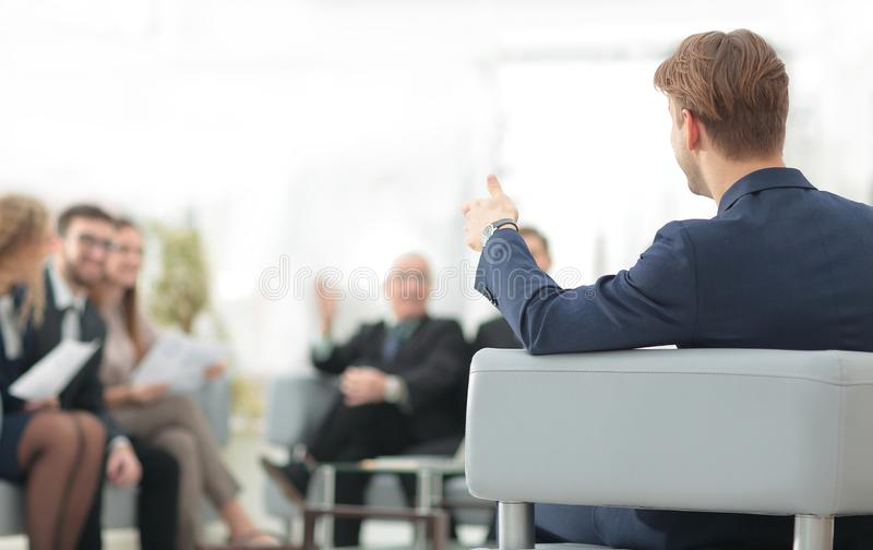 Image is blurred.businessman conducting a meeting stock photography