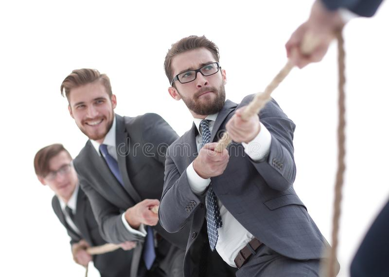 Tug of war between confident business teams. Image is blurred.a tug of war between confident business teams. photo with copy space royalty free stock photo