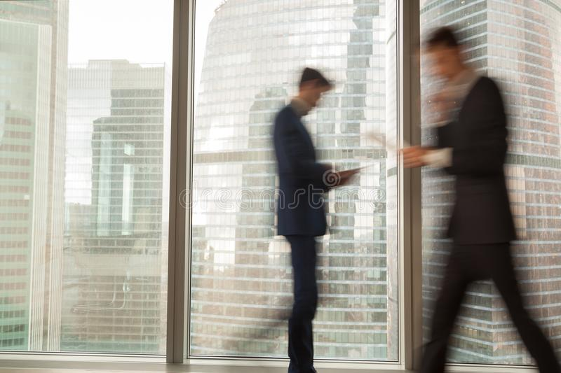 Busy businessman hurrying on business in office royalty free stock photos