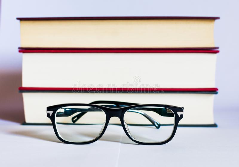 Image with books and glasses on white background stock photos