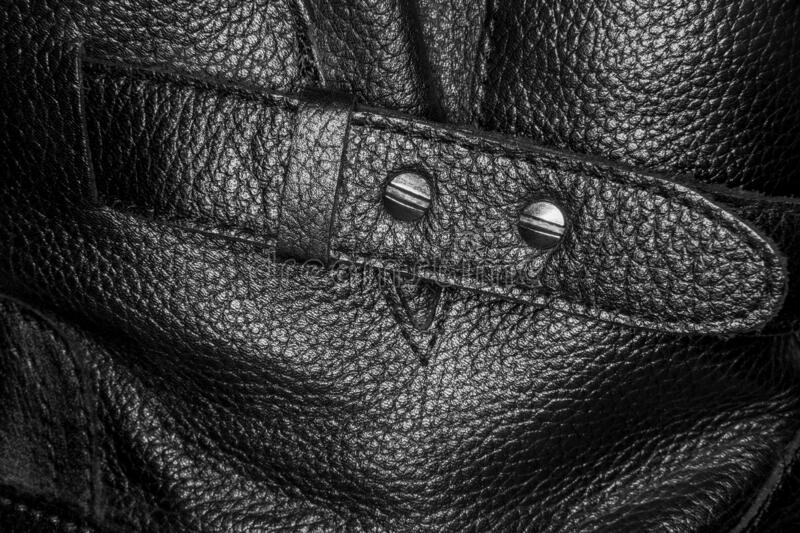 Buckle on a black leather boot stock photos