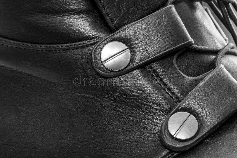 Buckle on a black leather boot royalty free stock photo