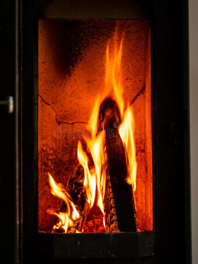 Image of burning wood logs in fire place royalty free stock photography