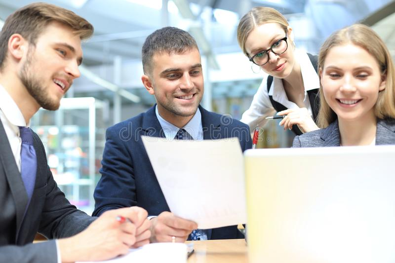 Image of business partners discussing documents and ideas at meeting royalty free stock photo