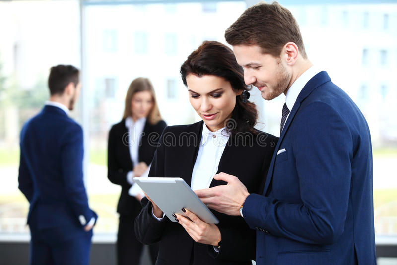 Image of business partners discussing documents and ideas stock photos
