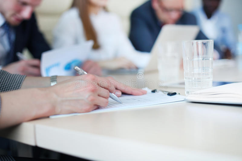 Image of business people hands. Working with papers at meeting stock photos