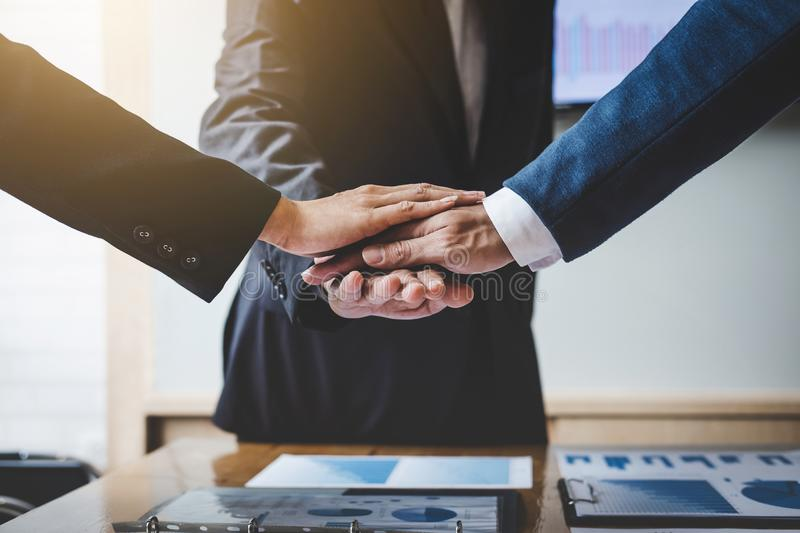 Image of business people joining and putting hands together during their meeting, connection and collaboration concept, Teamwork stock image