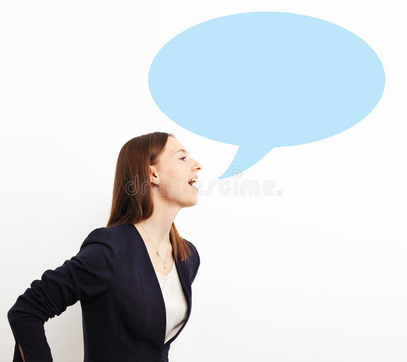 Image of business woman screaming in blank speech bubble on whi stock photography