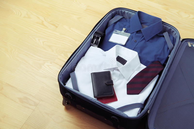 Image of businessman's clothes in travel bag royalty free stock photos