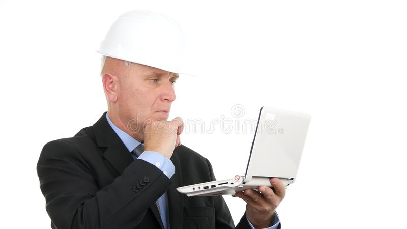 Image with Busy Engineer Using Laptop Communication royalty free stock photography