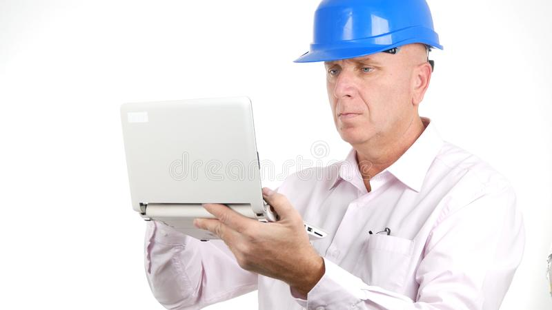 Image with Busy Engineer Using Laptop Communication royalty free stock photo
